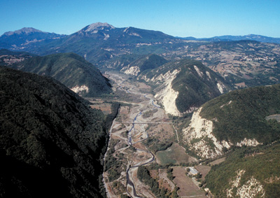 The triassic gypsum (in the foreground) carved out by the course of the river Secchia (Reggio Emilia Apennines)