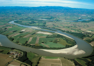 The river Po flows quietly in the Piacenza plain, forming these fully developed meanders. The stream flows from right to left.