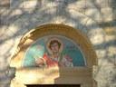 foto: mosaico sul portale d'ingresso della chiesa di S. Genesio raffigurante il Santo - Archivio Parco